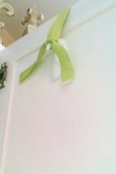 Use an upside down Command hook on the backside of a door to hang a wreath.