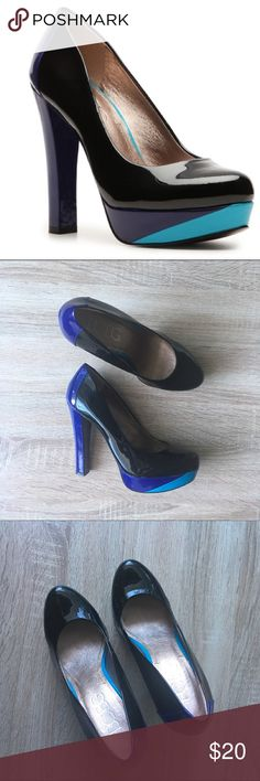 BCBG Paris Penie Colorblock Platform Heels EUC BCBG Paris Colorblock heels. Size 7, black, purple and a streak of turquoise make these a statement making pair of heels. Minor wear on the sole, please zoom in on photos to see condition. Heel is about 5 in tall with a 1 in platform. BCBG Shoes Heels