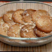 Malpua: A pancake like dessert which is soaked in syrup before serving. This version is made with paneer and khoya.