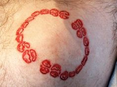 This guy had his wife make a bite impression in clay to have it cut into his shoulder. Cutting/removal scarification by Brian Decker of Pure Body Arts.