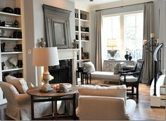 Since this is the living room – it was decided they really didn't need a traditional sofa – instead there is an antique Swedish daybed on one side of the fireplace and two slipped club chairs and ottoman on the other side.  An antique Spanish chair sits in between, acting as an accent.