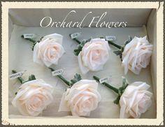 Vendela rose buttonholes