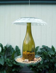 Oh goodness, I could feed entire flocks of birds, ha, so many wine bottles! DIY Wine Bottle Bird Feeder... great tips and instructions...