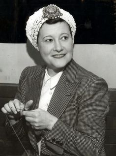 Odette Myrtil, knitting in her spare time in the 1940s
