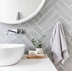 Grey herringbone tiling in this geometric bathroom. - Grey herringbone tiling in this geometric bathroom. Gray Shower Tile, Gray And White Bathroom, White Bathroom Tiles, Small Bathroom, White Tiles, Grey Wall Tiles, Bathroom Accents, Dyi Bathroom, Bathroom Inspo