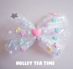"""☆ A holographic iridescent dream*¨*•.¸¸⋆*✩  ☆ cute hair bow and pin  ☆ made from magical glitter tulle ,holographic film / cellophane, iridescent bows and stars  ☆ size: 12 cm x 9 cm (4.7"""" x 3.5"""")  ☆ stars, and false pearls glued on bow ☆ iridescent fairy bows and plastic heart  ☆ Brooch &..."""