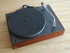 AR XA turntable. This minimal design includes a separate plastic dust cover that lifts off (no hinges). Platter is hi grade aluminum. There is no 33/45 RPM switch; to change speed, one must lift the platter and move a rubber belt underneath.  This model is also unique in having no anti-skate; in the 70s a perfect match was the Grado F1 phono cartridge which had anti-skate built into the needle itself.