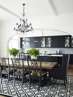 Chic black and white open plan dining room with black crystal chandelier over black trestle based dining table with salvaged wood top paired with black chippendale chairs and black wingback captain chairs over black and white geometric rug. Elegant Dining Room, Dining Room Design, Dining Room Furniture, Dining Room Table, Dining Rooms, Painted Dining Chairs, Dinning Chairs, Room Chairs, Home Modern