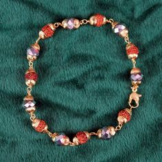 Redeem this Stunning Gold Plated Crystal Rudraksha Bracelet for FREE only on LooksGud.in #LooksGudReward #MenBrecelet