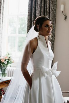 A Halterneck Jesus Peiro dress for a Black Tie Wedding at Iscoyd Park. Photography by Jade Osborne Photography