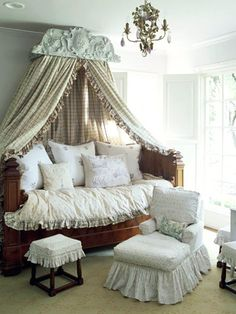 Beautiful Balance--LOVE THIS   Beautiful Balance  An architectural piece and a fruitwood daybed, both antiques, add structure to a light and airy room. A crisp canopy of ruffled plaid panels was hung from the architectural piece and cascades across the bed. Fluffy pillows and blankets make the space inviting and cozy