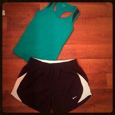 NIKE ✔️✔️ set jogger shorts small and teal tank This NIKE set includes: 1 pair of NIKE small colors black and white mesh on the corner. Built in underwear. And it also includes a extra small teal champion razorback with built-in bra. Perfect condition like brand-new!! Nike Shorts Cargos
