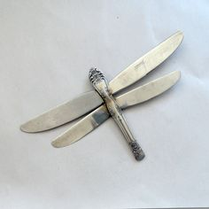 Metal Folkart DragonFly Upcycled Flatware Art Wall Sculpture or Ornament. $28.00, via Etsy.