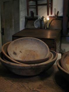 www.picturetrail.com/highbuttonshoe.  A stack of large dough bowls sit atop the harvest table. HighButtonShoe farmhouse.