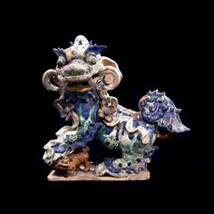 Ming glazed terracotta sculpture of a Fu Dog. Barakat Gallery