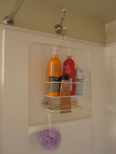 Hang a shower caddy on the opposite side of the shower with a coat hook so it doesn\'t interfere with the faucet.