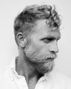 Mens hair and beard, blonde curls.