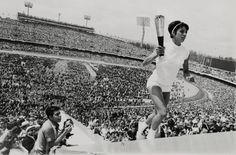Photo of Mexico's Norma Enriqueta Basilio, the first woman in the history of the modern Olympic Games to light the Olympic Fire by Darryl Heikes, October 12, 1968.