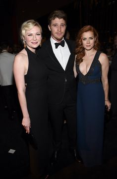Pin for Later: Hot Hollywood Stars Trade Halloween Costumes For Red Carpet Glamour  Kirsten Dunst and Garrett Hedlund got face time with Amy Adams.