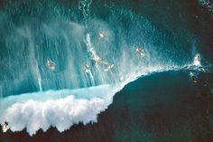 Surfers behind breaking waves at Sunset Beach, Oahu,HI (photo: Alex MacLean/Barcroft/Landov)