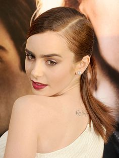 Lily Collins back tattoo