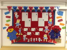 Paddington Bear display. Make tags, collage a bear and write descriptions. Children love watching the old TV episodes.