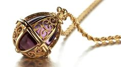 Beginning of life - Amethyst jewel with 14 carat gold - Kalevala Jewelry from Finland.
