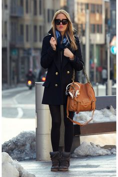HUGE sneakers and a classic peacoat.