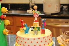 Gracie's Sesame Street Birthday Party birthday cake (Fisher-Price Sesame Street figures and custom clothespin doll ordered from www.etsy.com/...)
