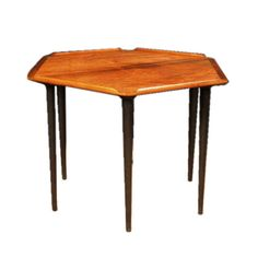 "A vintage Danish rosewood occasional table of hexagonal shape. CIRCA:1950 DIMENSIONS: 16"" h x 25"" d"