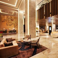 Swisstouches Hotel Xi'an by HBA Design - note: lobby reception's lighting on columns