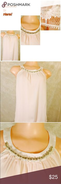 """XL 1X 2X 3X Sleeveless Summer Top Sleeveless blouse. With detail around neckline as well as lace border on the bottom. Measurements are as follows: bust: XL is 21"""" ✨✨✨1X is 22"""" across armpit to armpit ✨✨2X is 23""""armpit to armpit and 3X is 24"""" armpit to armpit all sizes are about 25"""" long Blue Note Tops"""