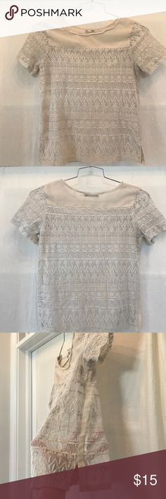 Grifflin Paris Cream Lace Top This is a really elegant top. Cream colored lace with thin side panels. The neckline has really pretty white beads. It's see through, so a nude tank works best underneath. The bust is 16' across and it's 22' from shoulder to hem. Grifflin Paris Tops Blouses