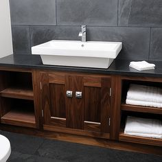 American Black Walnut vanity unit with honed black granite top and natural slate splashback combine to gives a masculine feel for this luxurious en-suite. #bathroom #relaxation #design #interiordesign #ensuite #luxuryliving #vanityunit