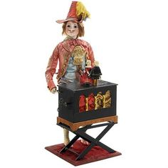 Musical Automaton Organ Grinder by Gustave Vichy, c. 1880 With rare bisque character head modeled as a man with open-closed mouth and two rows of painted teeth, moulded moustache, incised lines, brown paperweight eyes, shaded eyelids and feathered brows, standing behind a model barrel organ with brass pipe aperture, the going-barrel movement inside playing two airs as the figure cranks the organ, looks from side to side and nods his head left and right as though watching the miniature dolls…