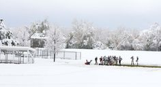 The junior high school Kaysville Attack football team practices Nov. 10 on a strip of green grass that was snowplowed clean so that the boys could get in some plays before their big football tournament in Mesquite. (Leah Hogsten  |  The Salt Lake Tribune)