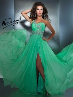 This gown has so much fabric, you can't help but play with it.  One shoulder strap has sequins and lazer cut detailing.  AB stones cut across bust and encompass the waistline.  Full circle cut chiffon skirt has split up front.