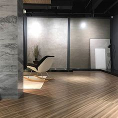 This contemporary lounge features Tigerwood timber effect thin porcelain floor tiles with antibacterial nanotechnology
