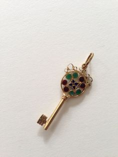 Vintage 18K gold and enamel key pendant by Unoaerre (Italian jewelry company founded in 1926).  Circa 1960...