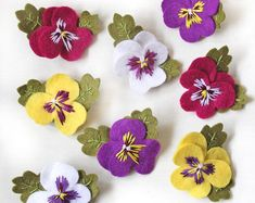 Pansy brooches hand embroidered felt pansy brooch available in purple white yellow and fuchsia pink floral gift viola flowersPansies are such adorable flowers, I couldnt resist making these little felt brooch versions! My pansy brooches are available Crewel Embroidery, Embroidery Patterns, Hungarian Embroidery, Embroidery Hoops, Embroidery Jewelry, Felt Flowers, Fabric Flowers, Fabric Flower Brooch, Felt Crafts