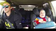 Dad takes young son car-racing, boy's face shows absolute shock and joy