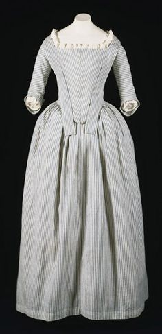 "Robe à l'anglaise: ca. 1775-1780's, American, striped cotton plain weave. ""This gown is a rare surviving example of the type worn by servants and the lower classes, or by middle class women for informal wear. The plain design and the use of cotton fabric are well suited to an informal dress, but also reflect the growing preference for simplicity during the 1770s and 1780s. At this time, dresses with closed skirts became popular; called ""round gowns,"" they were put on over the head..."""