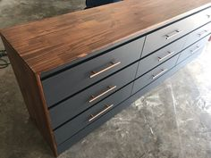 Our goal was to take two MALM chest of drawers and make them look like one, big dresser. After a lot of painting, a new top and sides, it turned out awesome