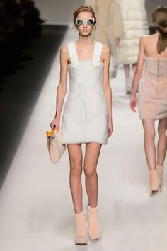Fall/Winter 2015-2016 fashion trends: Marshmallow colours | Fendi Fall/Winter 2015-2016 collection | dominated by natural hues such as white and beige; accent colours included red, orange, dark blue; materials: fur, leather, ; contrasting texture: smooth (leather), rough (certain fabrics), and hairy (LOL fur)