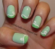 Adorable pastel green nails with artsy white squiggle design. Really pretty for spring!