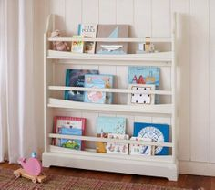 12 Functional and Cool Bookshelves For Kids: This cheerful Babyletto spruce tree bookcase ($199) adds a bit of whimsy to any tot's room. Holding 12 to 15 books per branch, this bookshelf is seriously functional. Crafted from poplar hardwood and finished with low-VOC lacquers, the bookshelf attaches securely to any wall in your child's room. : Here's a charming Land of Nod dollhouse bookcase ($299) that's perfect for any sweet girl's room. Use sections for storing books and others for…