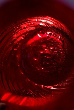 macro image of the inside of a red coloured glass jug