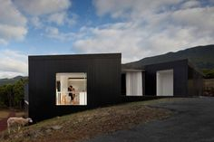 This house aims to overlook the various views which can be seen from the highest point of the land. Starting from a set of separate volumes and following the adaptation of the traditional architecture to the terrain, the resulting area between the four volumes was designed as a living space, the walls of which are a continuation of the exterior façades and where only glass separates the exterior from the interior space of the home - Açores, Portugal