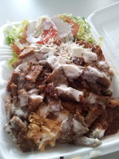 New York - Halal stand Chicken and lamb mix over rice with red and white sauce