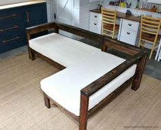 DIY Crib Mattress Sectional Sofa - Jaime Costiglio - A DIY tutorial to build a sectional style sofa using two crib mattresses for cushions. A sofa you can build yourself and reuse old crib mattresses. Outdoor Couch, Diy Outdoor Furniture, Furniture Projects, Furniture Makeover, Bedroom Furniture, Furniture Design, Outdoor Dog, Diy Bedroom, Furniture Outlet